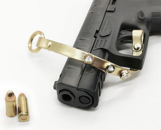 Bracciale Pelle oro. Bracciale pelle oro con proiettile calibro 9mm e swarovski