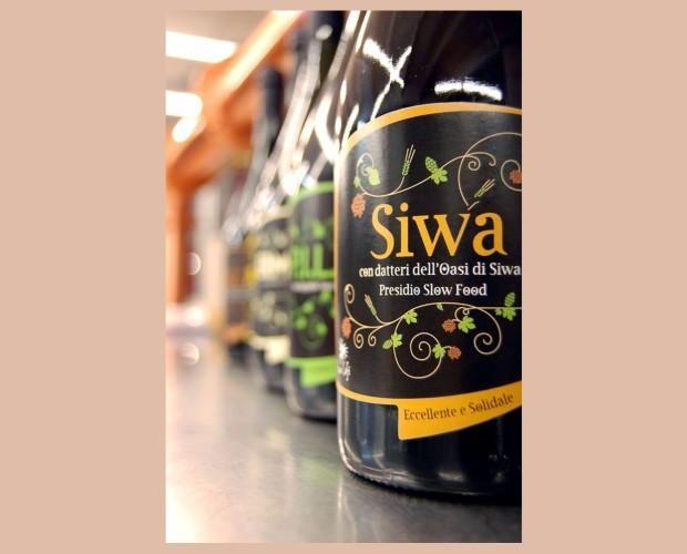 Bottiglie di Birra con alcol.Birra Artigianale Aromatizzata ai datteri