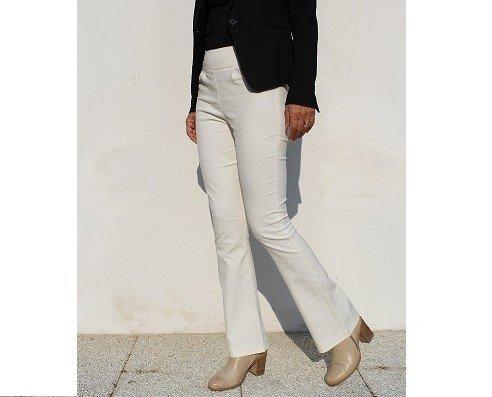 Pantaloni in vellutino. Pantaloni a zampa in vellutino, vita alta, cerniera invisibile sul fianco.